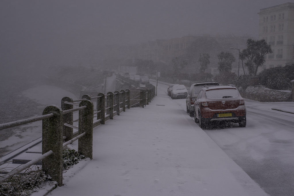 Heavy snow is blown in over Cliff Road, Falmouth. 2018