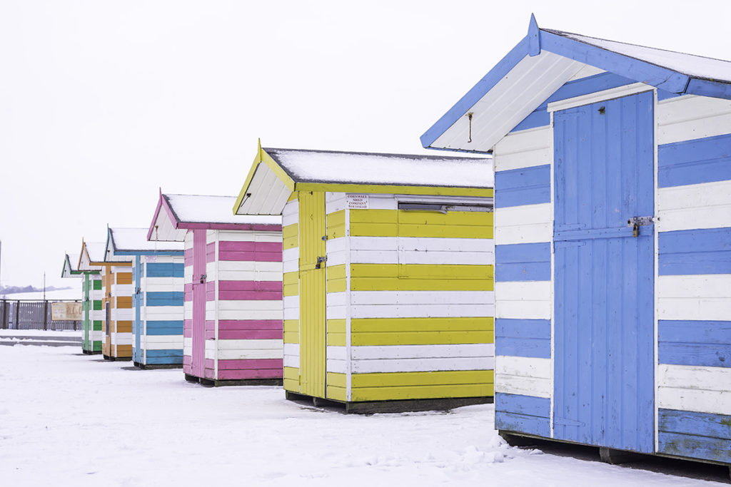 Falmouth Event Square coloured huts in snow 2018