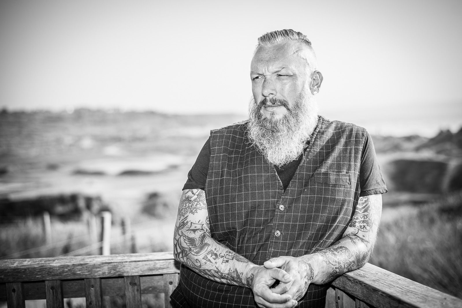 Plus-Sized Male Model poses for LLE Photography, a portrait photographer in Cornwall