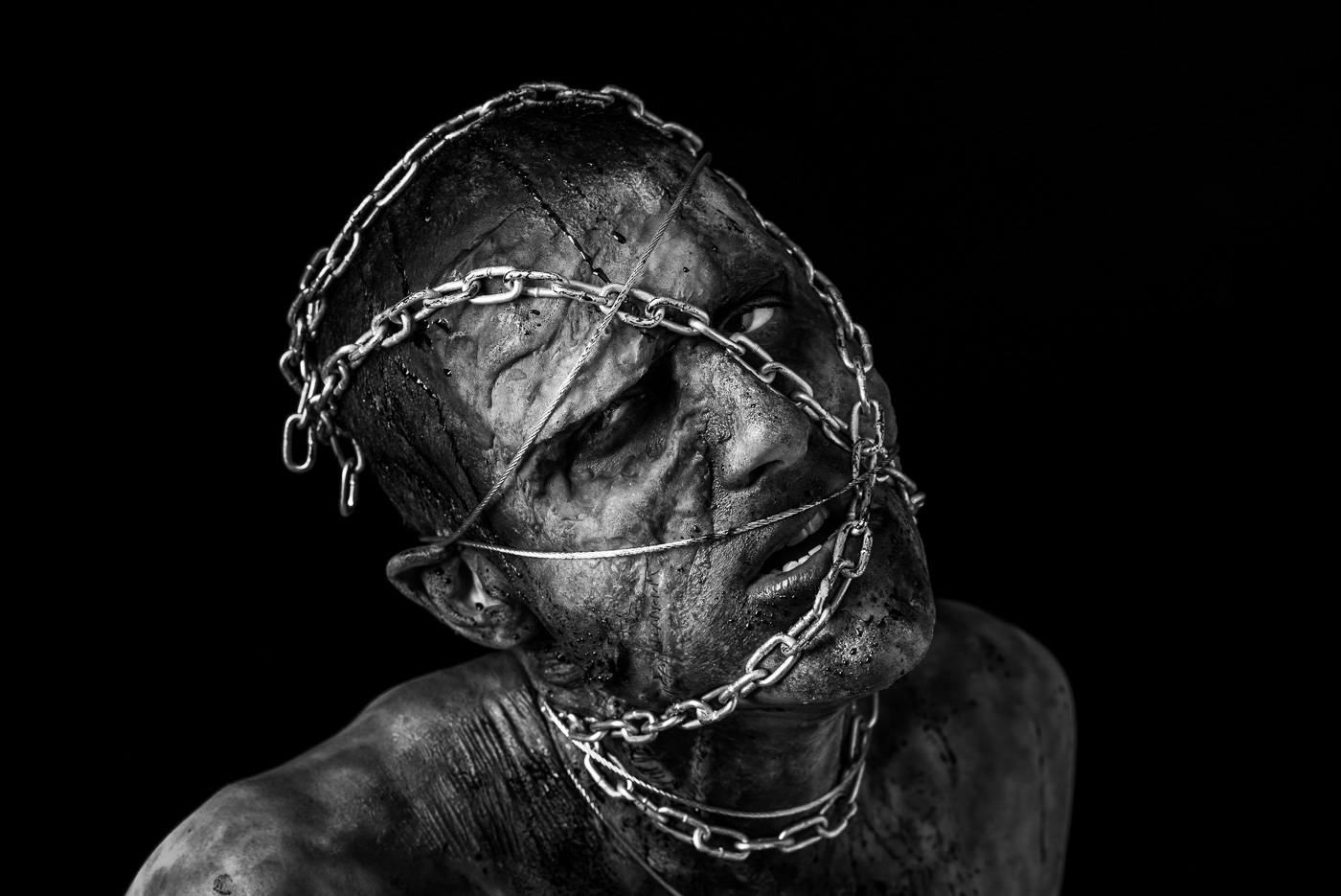 """Man in Chains"" A contemporary studio photograph taken by Claire Wilson LLE Photography"