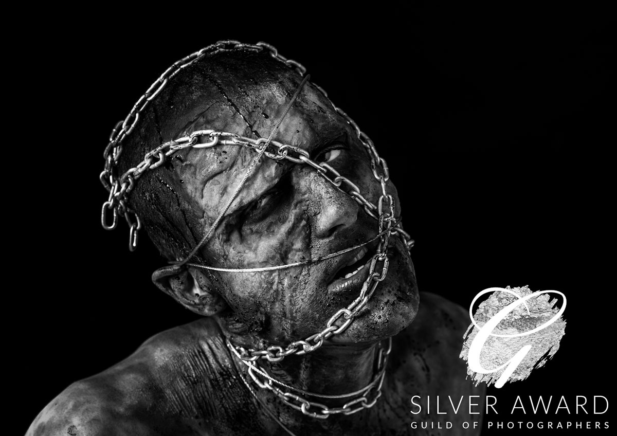 Man in Chains - Silver Award in The Guild of Photographers Image of the Month