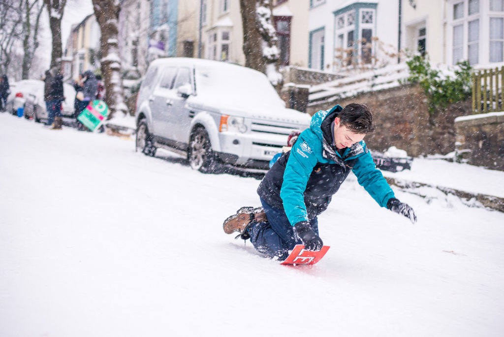 Using a signboard for a sledge in Falmouth