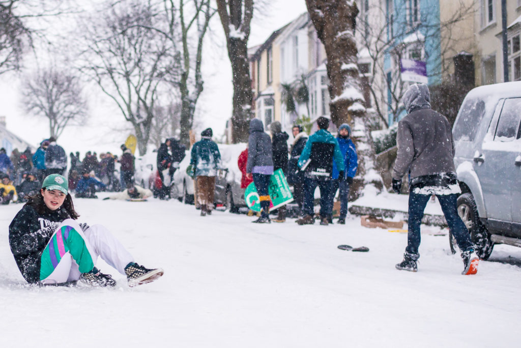 Student uses baking tray as sledge in Falmouth
