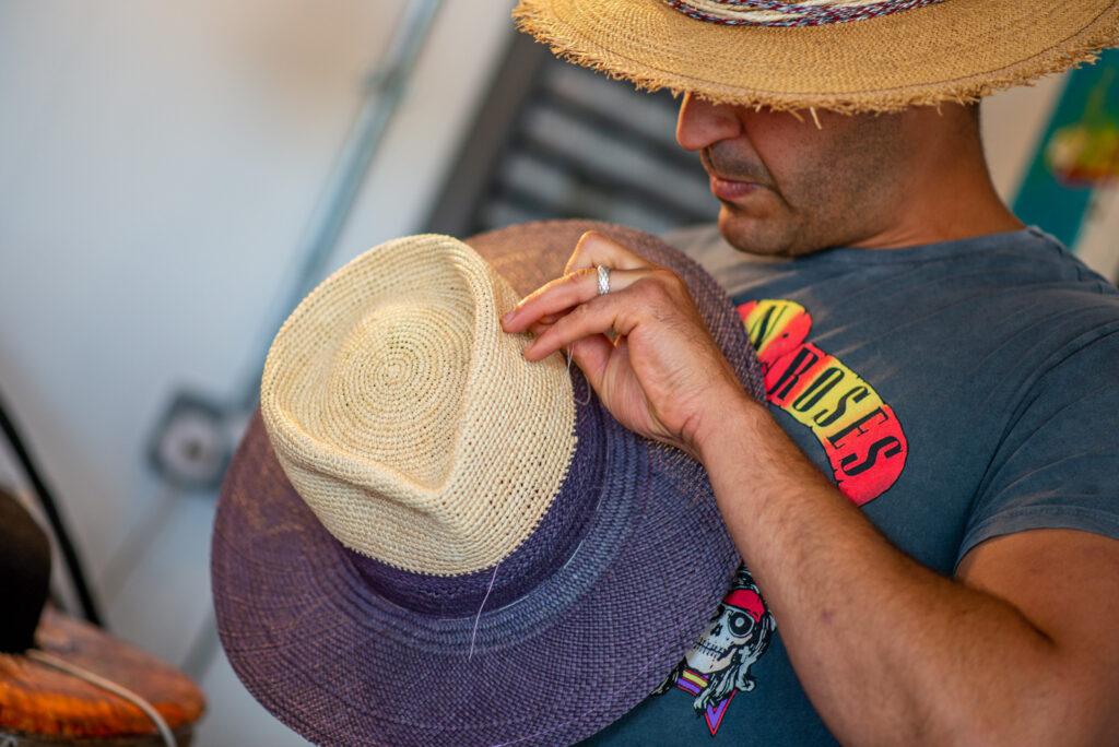 Photographer in Cornwall photographs expert hat maker
