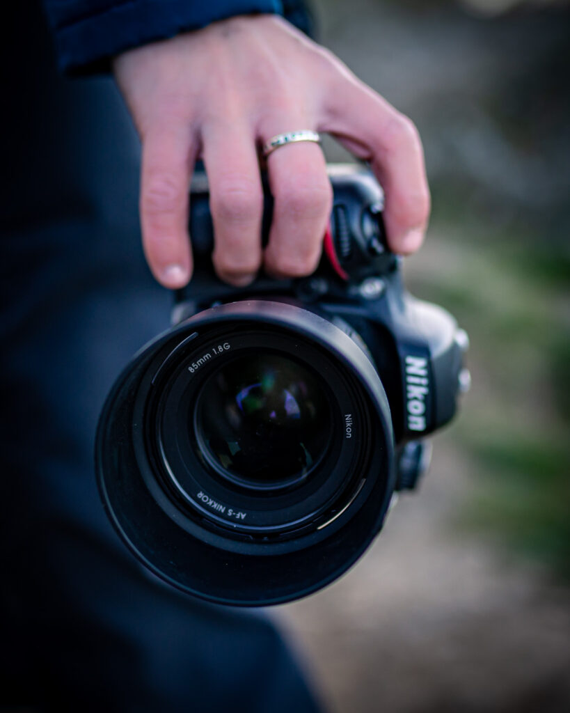 Best photographer in Cornwall - photograph of photographer holding camera